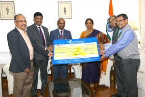 Photo caption: Mr M V Gowtama, CMD, BEL, presenting the 40% Final Dividend cheque for Rs. 64,41,62,053.20/- (Rupees Sixty-four crores Forty-one lakhs Sixty-two thousand Fifty-three and paise Twenty only) for the year 2017-18, payable on the shares held by the President of India and Government nominee, to the Raksha Mantri, Mrs Nirmala Sitharaman, at New Delhi today, November 15, 2018. Also seen in the picture are (Left-Right) M M Joshi, Executive Director (National Marketing), BEL,Koshy Alexander, Director (Finance), BEL, Dr Amit Sahai, Joint Secretary (P&C) & Part-Time Government Director on the BEL Board, and Barun Mitra, Additional Secretary (Defence Production). BEL has paid a total dividend of 200% to the Government of India for FY 2017-18.